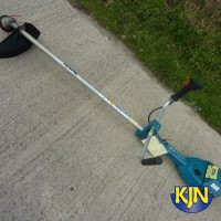 Strimmer with Helmet and Ear Defenders